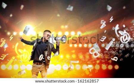 Image of young man musician singing in megaphone - stock photo