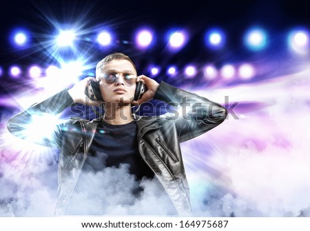 Image of young man rock musician at concert - stock photo