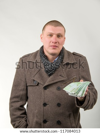 Image of young man with money in hand - stock photo