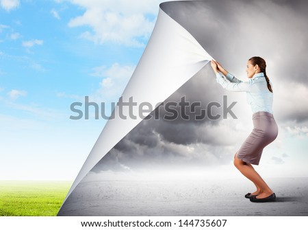 Image of young pretty woman changing reality - stock photo