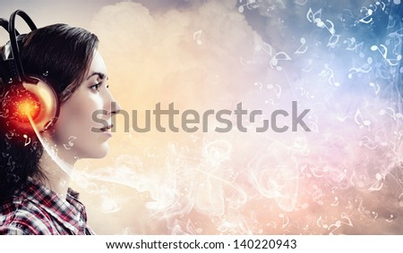 Image of young pretty woman with headphones. Side view - stock photo