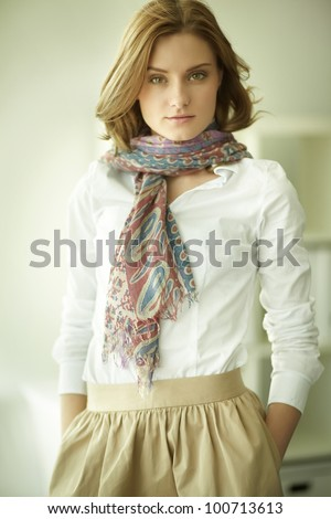 Image of young stylish woman looking at camera - stock photo