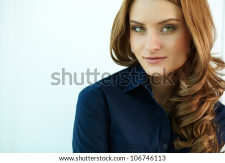 Image of young woman looking at camera - stock photo