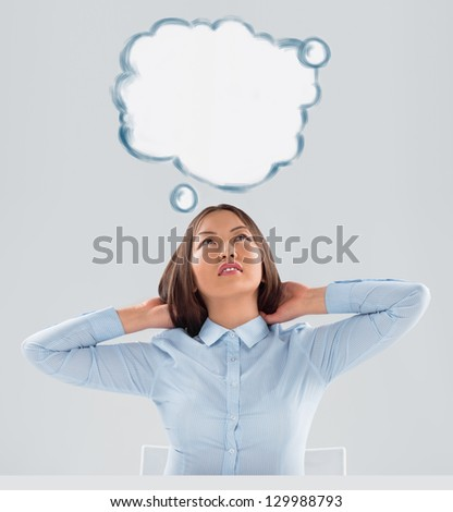 Image of young woman thinking of her plans. Lots of copyspace inside graphic cloud for your text - stock photo