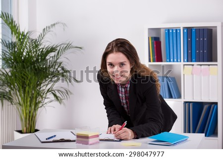 Image of young woman working in agency - stock photo