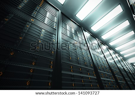 Image presents a bottom view of a room equipped with data servers. Yellow LED lights are flashing. - stock photo