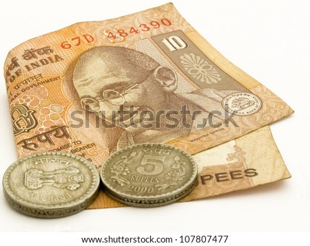 Image showing Indian 10 rupee note with 2 5 rupees coins with image of Mahtma Gandhi on note. - stock photo