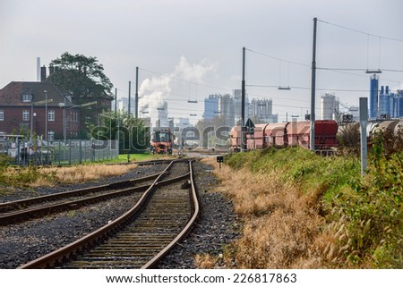 Image showing industrial chimneys, smoke fumes and demonstrating pollution in the atmosphere, a major issue with organizations intent on saving the planet - stock photo