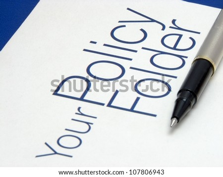 Image showing text policy Folder with pen on isolated blue background. - stock photo