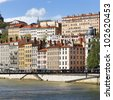 Image shows a series of colorful buildings in the city of Lyon - stock photo