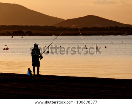 image taken from a fisherman to the light at dusk - stock photo