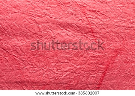 Image texture of crumpled ped paper. - stock photo