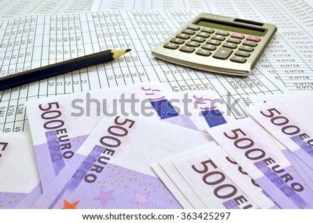 Image the euro money with calculator and financial tables with numbers - stock photo