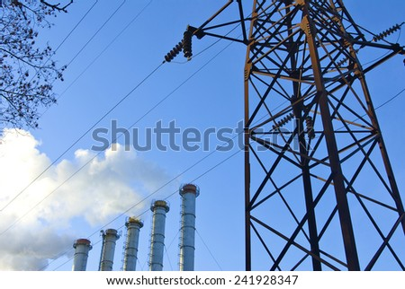 Image unhealthy smoke from the chimney against the blue sky - stock photo