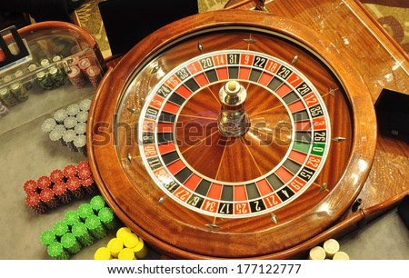 image with a casino roulette wheel with the ball bird eye view - stock photo