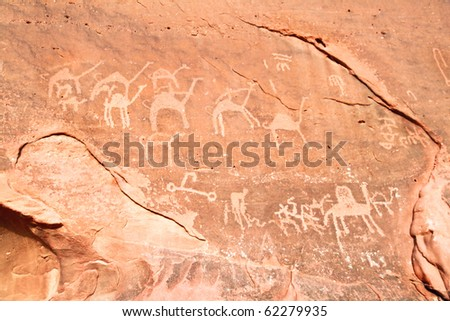 Images of  camels carved into a rock wall at Wadi Rum, a UNESCO World Heritage site in Jordan. - stock photo