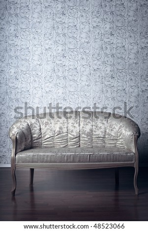 Images of the glamorous sofa in the background of vintage wallpaper - stock photo
