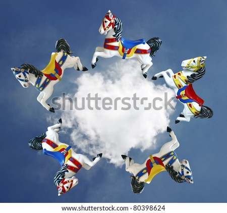 Imaginary colorful horse galloping around a cloud in a blue sky. - stock photo