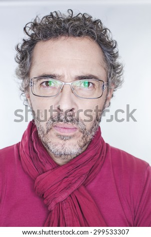 imaginative middle age man with salt and pepper hair and glasses focusing, concentrating on new world destinations - stock photo