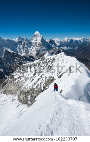 Imja Tse or Island peak climbing, with Mt.Ama Dablam in background, Everest region, Nepal. - stock photo