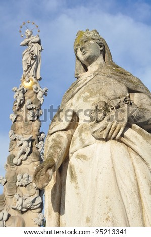 Immaculata - plague pillar (slovak: morovy stlp) and a religious statue in town square of Kosice, Slovakia. - stock photo