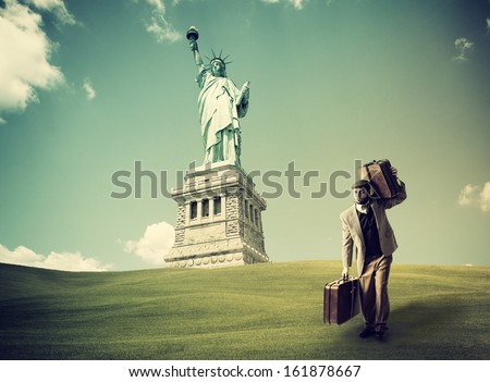 Immigrant with the suitcases arriving in New York - stock photo