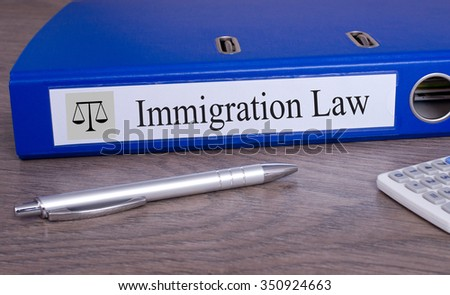 Immigration Law Binder with blue color on desk in the office - stock photo