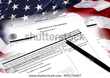 Immigration naturalization application and USA flag concept of citizenship and American patriotism. - stock photo