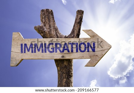 Immigration wooden sign on a beautiful day - stock photo
