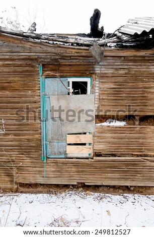 Immured window of ruins of the old wooden house in Astrakhan, Russia. - stock photo