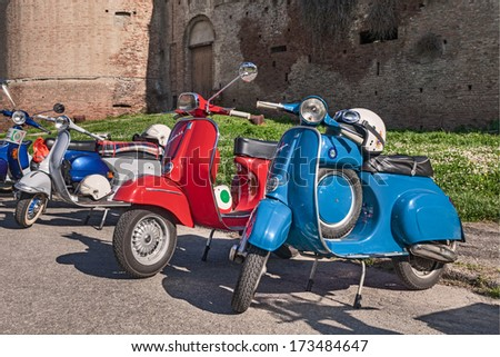 """IMOLA (BO) ITALY - APRIL 14: vintage italian scooters Vespa parked during the classic scooter rally """"IV Vespa in fiore"""" on April 14, 2013 in Imola (BO) Italy - in foreground the model 90 Super Sprint - stock photo"""