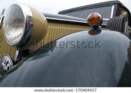 IMPERIA, ITALY - MAY 25: Close up detail of a classic car parked in a street in Imperia, Italy on May 25, 2012 during raid of vintage cars. - stock photo