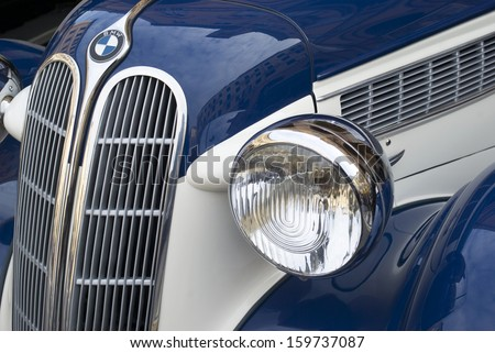 IMPERIA, ITALY - OCTOBER 19: Close up detail of a BMW 327 cruising on the road during raid of vintage cars in Imperia, Italy on October 19, 2013. - stock photo