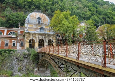 imperial austrian baths and wrought cast iron bridge in Baile Herculane, Romania - stock photo