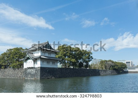 Imperial palace moat and a castle in Tokyo - stock photo