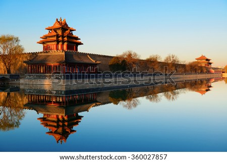 Imperial Palace over lake in the morning in Beijing. - stock photo