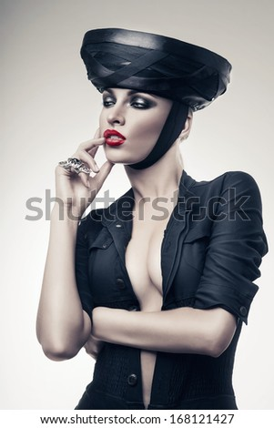 imperious strict woman in black with red lips - stock photo