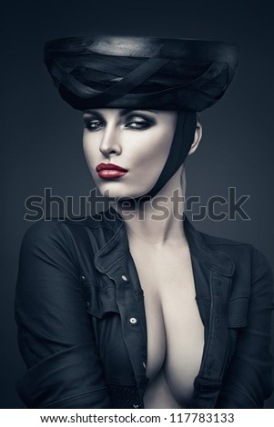 imperious woman in black with red lips - stock photo
