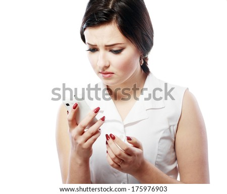 Important Text Message. Teenage girl looking concerned with a text message on her phone. Note: Not Isolated.  - stock photo