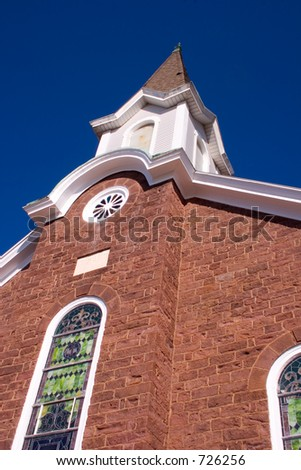 Imposing view of a church steeple - stock photo