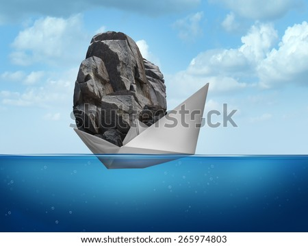 Impossible concept as a paper boat transporting a heavy rock boulder as a business symbol for overachieving and the power of determined potential to do things that are unbelievable. - stock photo