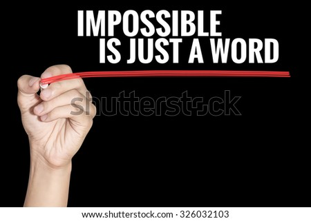 Impossible is just a word word writting by men hand holding highlighter pen with line on black background - stock photo