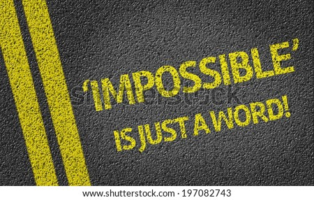 Impossible is just a word written on the road - stock photo