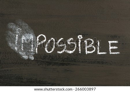 Impossible replaced by possible message isolated on black background. Chalk drawing on blackboard. Business Concept image. - stock photo