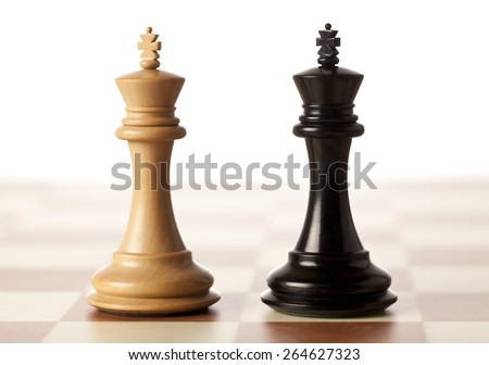 Impossible situation - two chess kings standing next to each other - stock photo