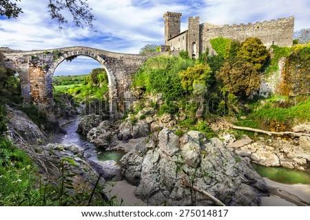impressive ancient bridge and castle Vulci - Lazio, Italy - stock photo