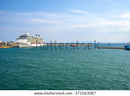 Impressive cruise ship at the port of Piraeus, Athens, ready to sail to the greek islands. - stock photo