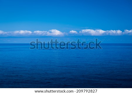 Impressive interesting clouds, sea painted in evenings intense deep blue color. - stock photo