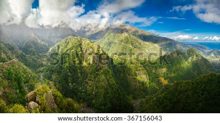 impressive panoramic view of the Madeira's peaks from levada Balcoes, Portugal - stock photo