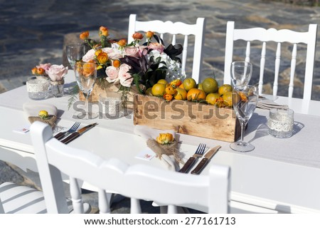 Impressive wedding table setup tangerine concepted - stock photo